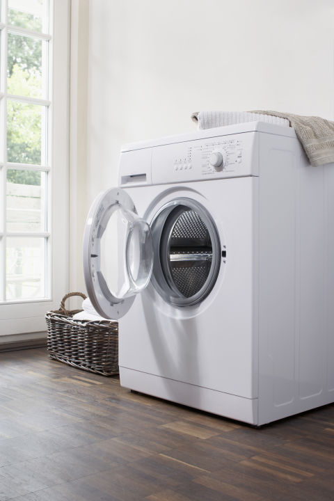 """Washing machines will smell a bit in the summer, especially in areas with high humidity,"" says Smallin. ""Run an empty load with detergent and hot water. Once it's done leave the door ajar so it dries properly and gets air circulation."""