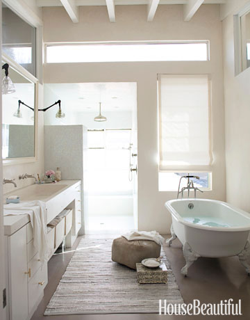 In the master bathroom of photographer Amy Neunsinger's light-filled L.A. home with a loft-like feel, a claw-foot tub from Sunrise Specialty adds a period touch. Waterworks faucet.