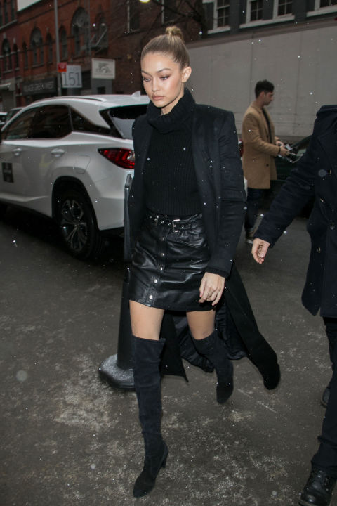 Hadid looked sleek in the snow donning an all-black ensemble of a turtleneck, leather mini and thigh high boots.
