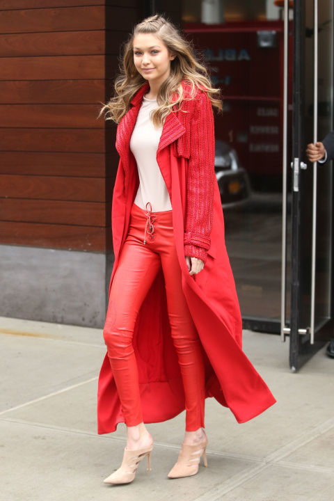 The model stepped out two days after Valentine's Day in a monochromatic red look, complete with leather pants, a duster jacket and pointy-toed pumps. She paired the look with a french braided center part.