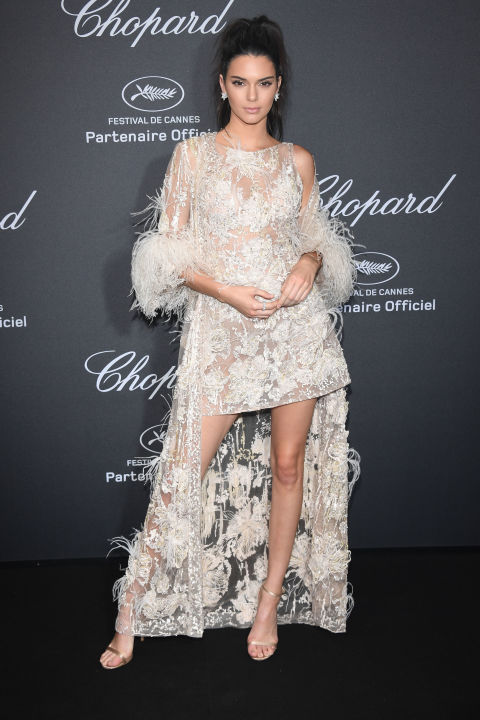 "Kendall Jenner ruled the night at the Chopard Wild Party in Cannes in an Elie Saab Haute Couture embellished mini dress paired with a matching feather-trimmed duster coat, Chopard jewels and Jimmy Choo stilettos. For the aisle, wedding day separates that give the illusion of a gown at the altar but free your legs up with a shorter length for dancing are the best of both worlds. Get the look: Naeem Khan ""Bolivar"" ensemble, price upon request, naeemkhan.com"