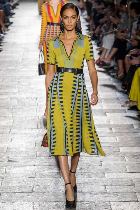Print and pattern showed up via relaxed floral dresses or a series of graphic knits belted tight, with open collars and full skirts. So effortlessly chic was Joan Smalls in a yellow, blue and black pattern and carrying a little printed python bag, she may as well have been sightseeing along the canals of Venice.