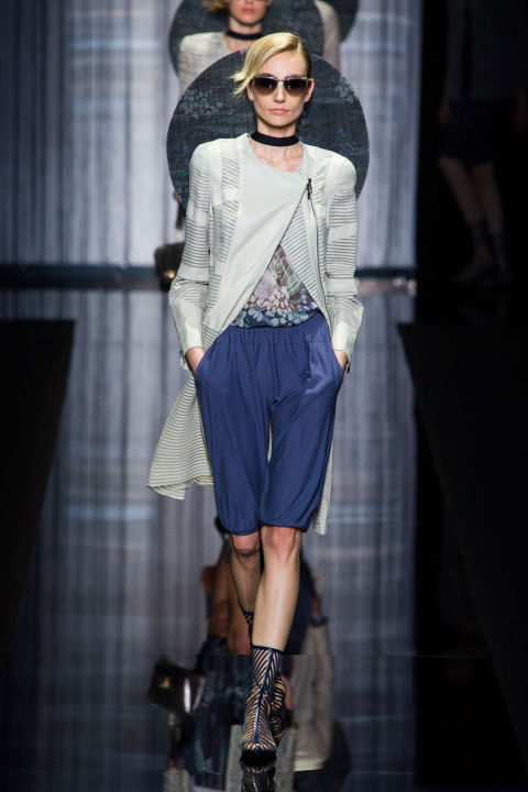 """Charmani. Giorgio Armani got a little cheeky and launched a new hashtag, calling his spring collection """"Charmani"""". His meaning? The elegance and sensuality, the magic and femininity, his show notes said. And he backed it up by sending out drape-y sarong-style shorts paired with relaxed jackets and coats."""