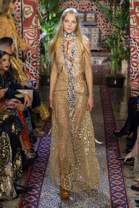 And yes, there was leopard. This is the house that Roberto Cavalli created, after all. For spring, it showed up in pared-back (for Cavalli) gold lace dress that sizzled.