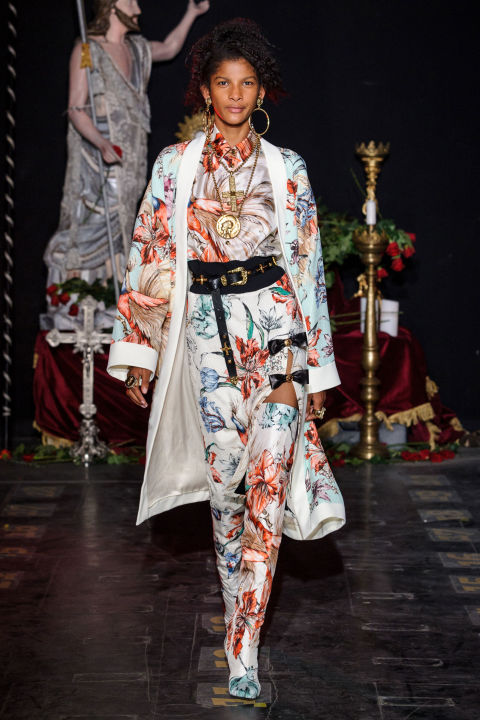 Fausto Puglisi's spring show was about naughty nuns and sinning saints. Or was it pious rockers? However you flip it, it certainly wasn't for prudes or simpering wallflowers. No, Puglisi likes a girl who's feisty and unafraid to wear leather bows, spliced denim and show a little leg.