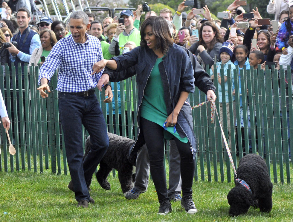 Playing with their dogs, Bo and Sunny, at the White House, March 2016.
