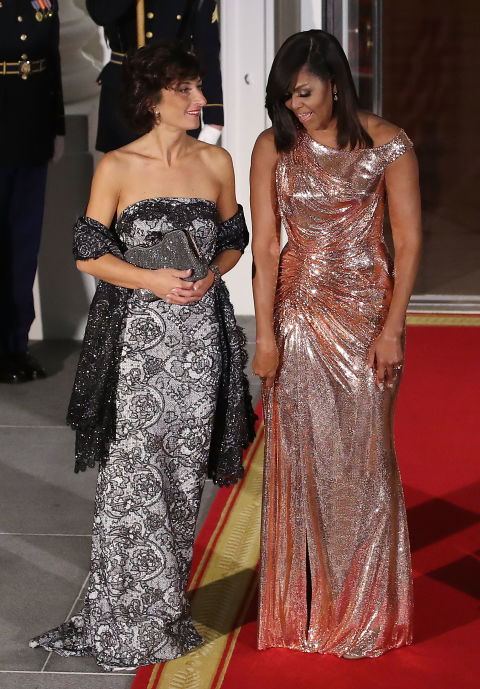 For her final State Dinner as FLOTUS, Michelle Obama wore an incredible rose gold gown by Versace and completely lit up the White House.