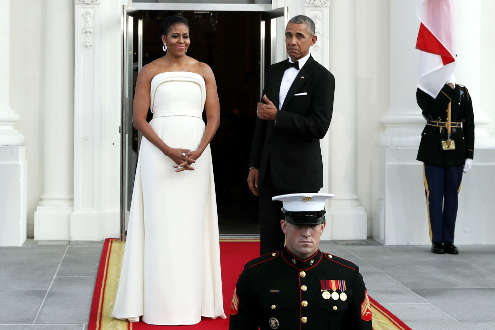 The President gives another thumbs up for his wife's flawless style in this strapless white dress by Brandon Maxwell.