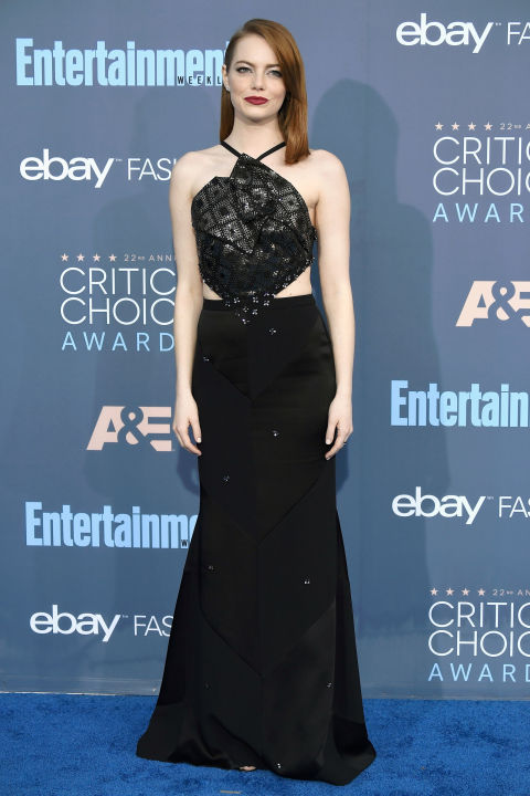 In Roland Mouret dress with Christian Louboutin clutch, Cartier jewelry and Jimmy Choo heels.