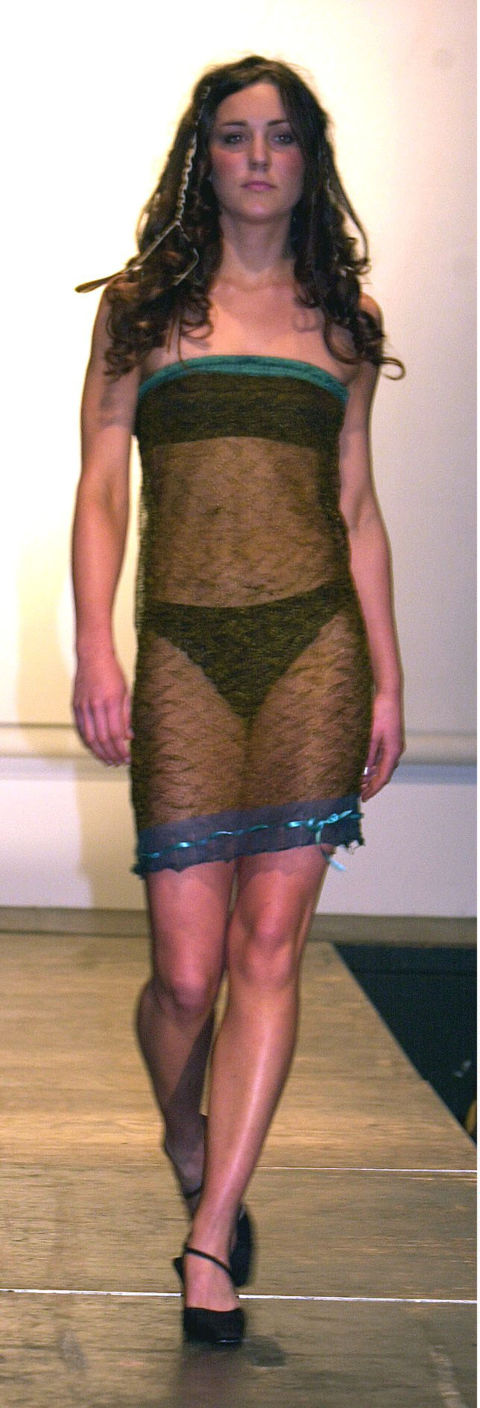 It's unlikely that the Duchess of Cambridge would wear such a daring dress today (she prefers a full-skirted midi look now), but in 2002 she bravely took part in the St Andrews University fashion show wearing a sheer knit tube dress. It was, apparently, the outfit that wooed Prince William.