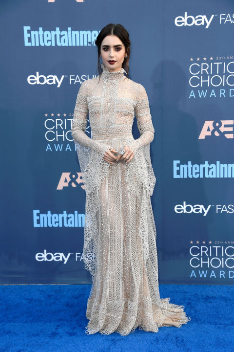 Lily Collins channeled gothic, romantic and borderline Miss Havisham vibes on the Critics Choice Awards blue carpet in Elie Saab–and we could not have loved it more. Her mussed hair and deep plum lip elevated this otherwise vintage, feminine look with a much-needed dose of high-brow edge. Get the Look: Costarellos Style #BR1719 dotted swiss Victorian neck gown, Price Upon Request, costarellos.com.