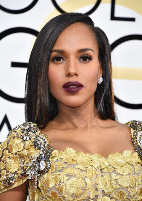 Washington rocked one of the most statement-making lip colors of the night: an inky plum shade that perfectly complemented the golden tones of her gown.