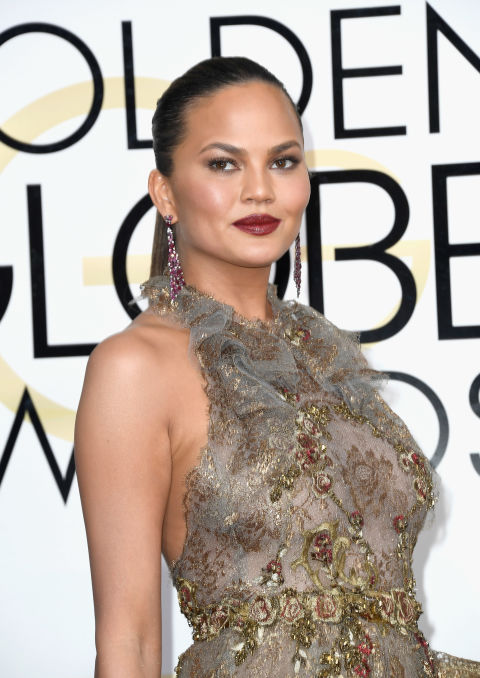 A slick, brick-red lipstick shade is all Chrissy Teigen needs to make a major beauty statement.
