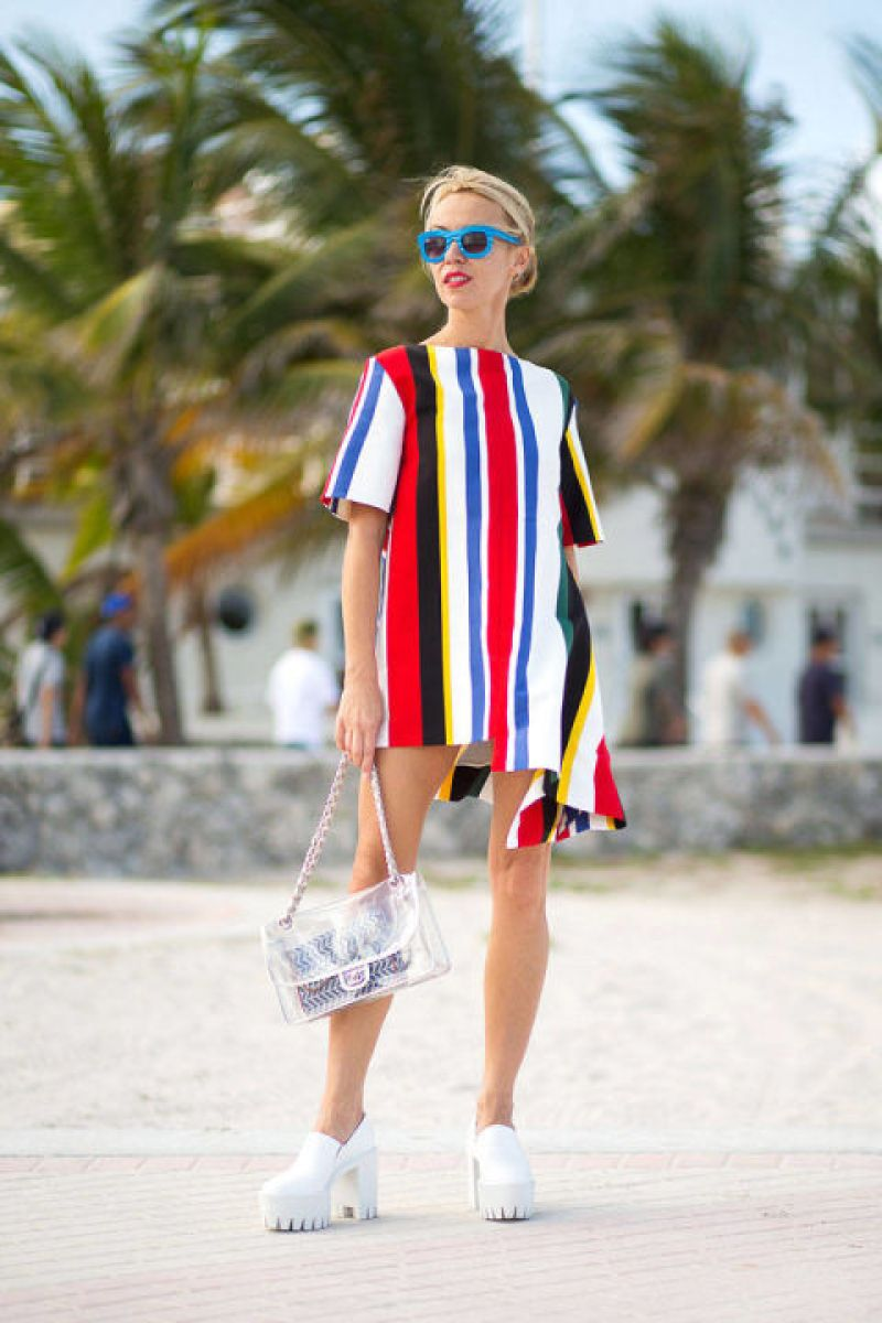 Sure, black is classic and flattering and safe—but it can also be boring. Liven up your look with a bold dose of color, like this bright Marni dress, or at the very least a little pop.<br /><br /><br />