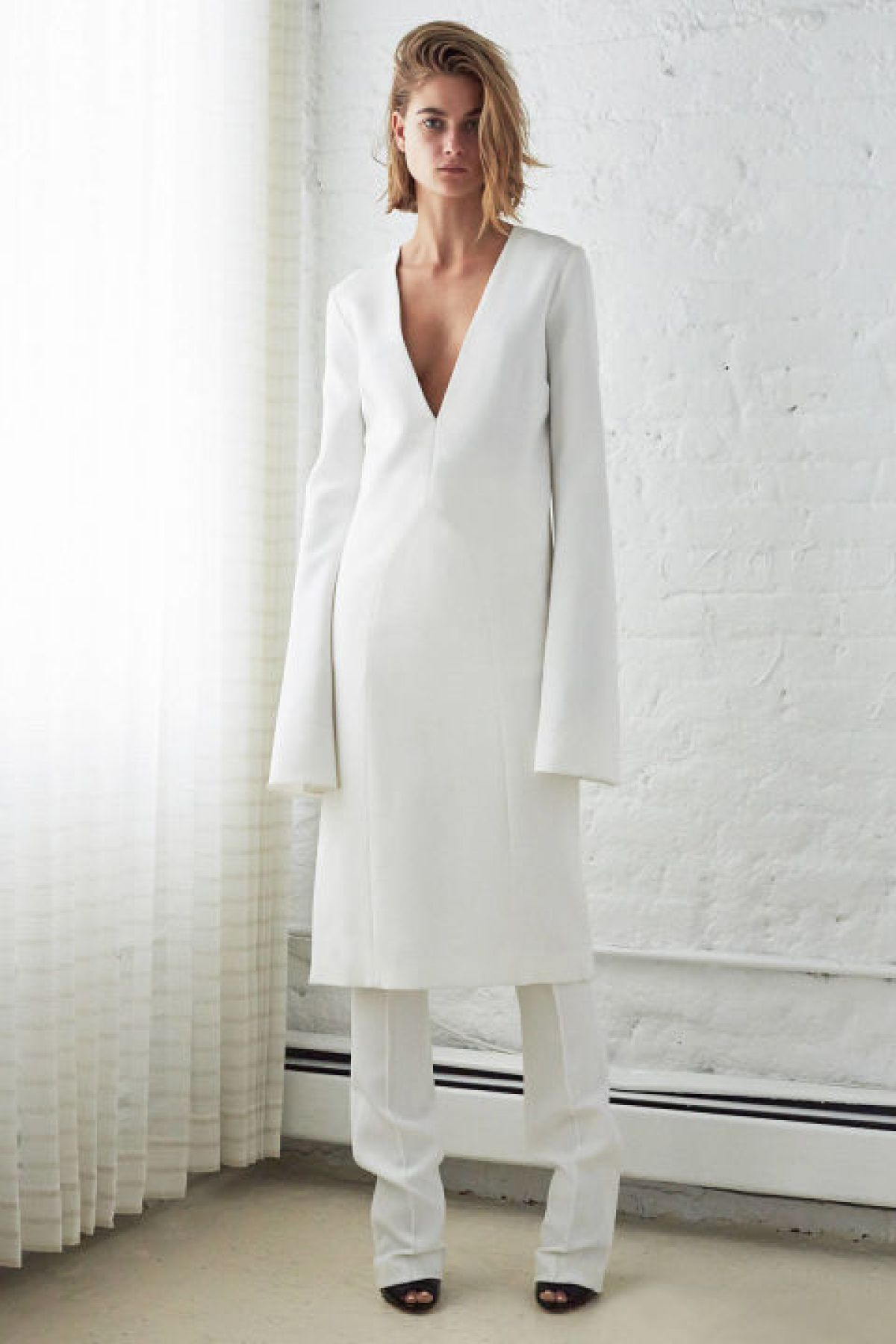 For those indecisive moments, the dresses-over-pants trend is the best of both worlds—and the new standard in louche layering.<br /><br /><br /> (Pictured: Ellery)<br /><br /><br />