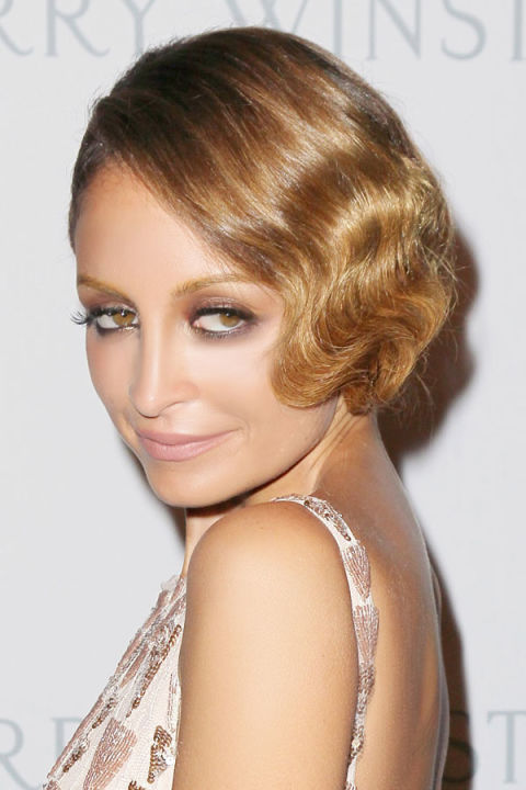Flapper girl curls never looked so chic as right now. Luke Chamberlain, Nicole Richie's hairstylist, set hair in waves using a 3/4 inch curling iron, spraying each section with Kérastase Resistance Double Force ($39) hairspray for a strong hold. He then brushed out the curls into soft bends and pinned up the hair into a faux bob. A final shot of hairspray and a spritz of Fekkai Brilliant Glossing Sheer Shine Mist provided the rich, glossy finish