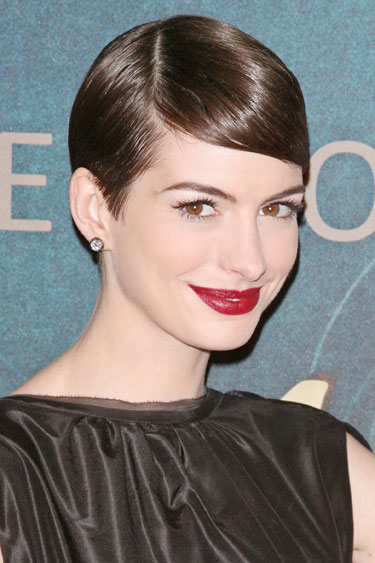 The trick to creating a flattering side-part? Line it up with the outer corner of your eyebrow, says Frederic Fekkai celebrity stylist Adir Abergel, who worked this look on Anne Hathaway. This gives you a soft sweep that frames your face and brings out your cheekbones—no blush required. Seal it in place with a high shine gel.