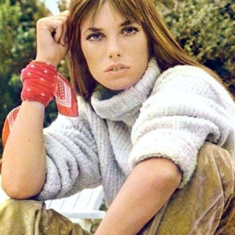 Jane Birkin's bandana at the wrist lends a pop of color and attitude.<br />