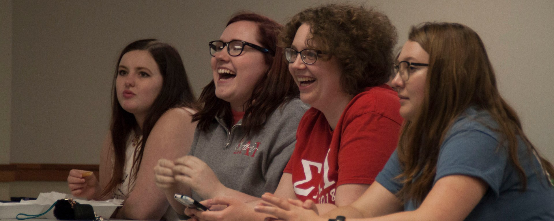 Sisters from Sigma Alpha Iota laugh at a question during the Greek Think on Tuesday.