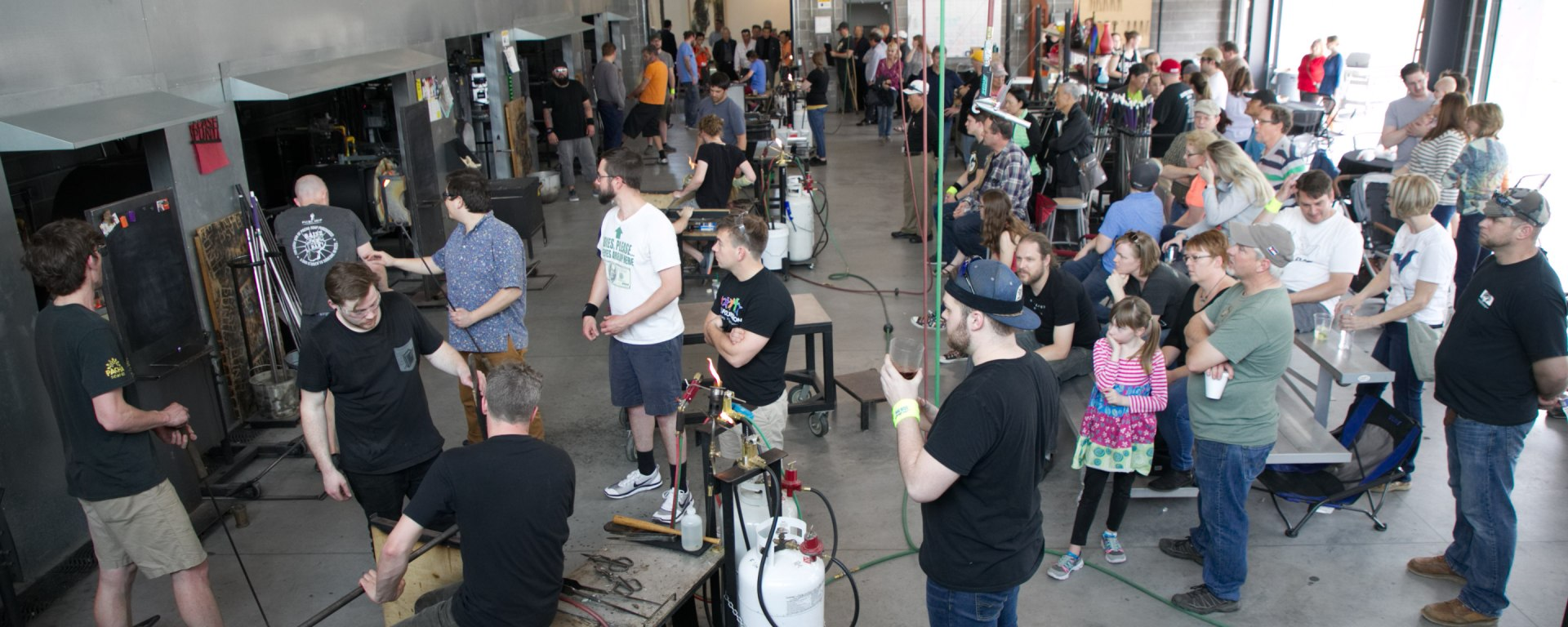 Around 150 people filled the JDAC on April 6 to blow glass and raise funds for Kreager.