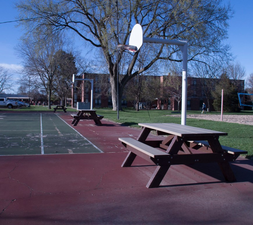 Three new picnic tables will be replacing the ones previously in front Altman Hall on the basketball courts.