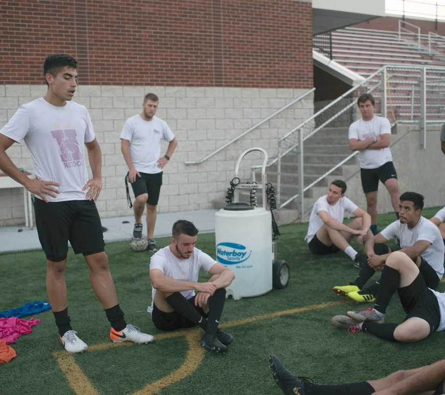 After practice on September 10, the men's soccer team gathers around to listen to Junior Captain Francisco Arevalo about what the purpose behind wearing their shirts inside out for practice and also to bring awareness of suicide.