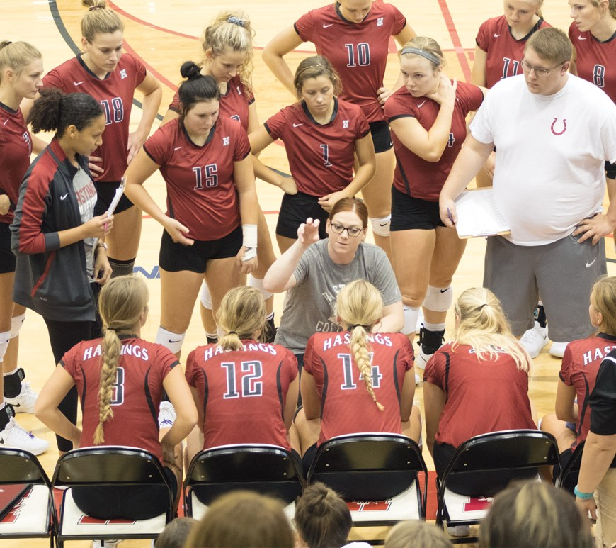 Broncos' new Volleyball Head Coach Alex Allard grasps the attention of all her players and staff during a timeout as she discusses a new attack for her team.