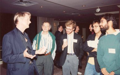 Ted Nelson holds forth in discussion with Norbert Streitz and others at the Hypertext 1989 Conference in Pittsburgh, PA.