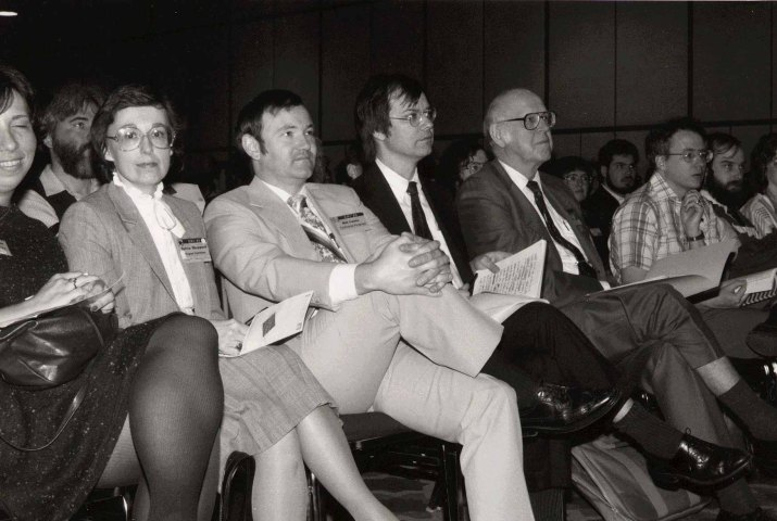 Alan Newell sits with Sylvia Shepard, Bill Curtis, and Stu Card (left to right) at the ACM CHI Conference on Human Factors in Computing Systems in San Francisco, CA on April 14, 1985.