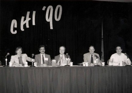 Nielsen (center) speaks on a panel with Kate Ehrlich, Gary Marchionini, Dennis Egan, and Gary Perlman (left to right) at the ACM CHI Conference on Human Factors in Computing Systems in Seattle, WA in June 1990.