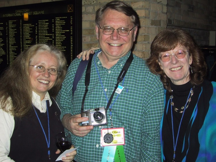 Olson with Wendy Kellogg (left) and Jennifer Preece (right) at the ACM CHI Conference on Human Factors in Computing Systems in Minneapolis, MN in April 2002.