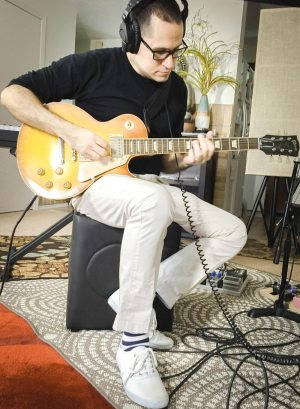 Victor Guest playing guitar