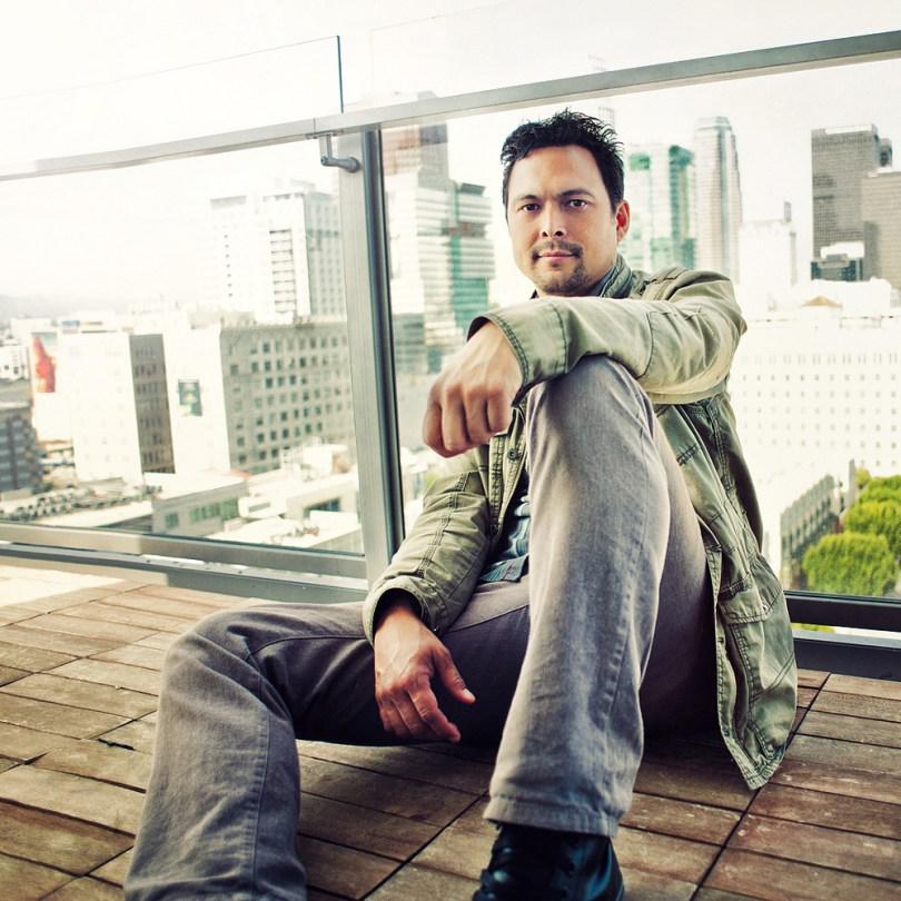 Image of a man sitting on the deck of a highrise