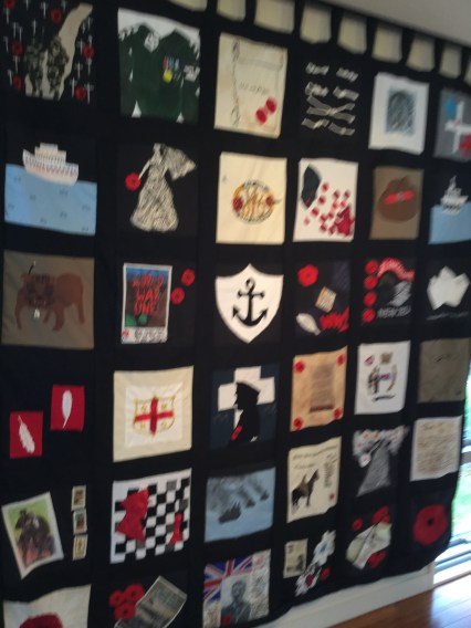 A quilt made of patches with war symbols