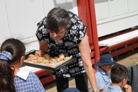 Mrs de Koning hands out our Hot Cross Scones
