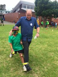 Mr Young competing in the Three-legged Race.