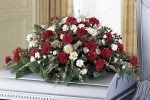 Stock image of Casket with Flowers