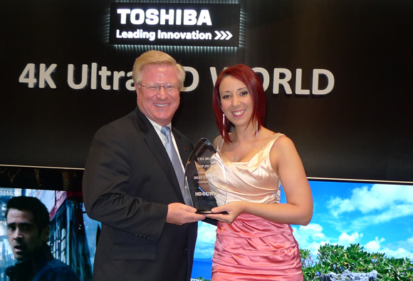 Toshiba America Information Systems CEO Mark Simons accepting the HD Guru Best UHDTV Award from our presenter Tiffany