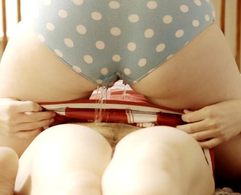 Olivia pees through her panties onto Alisha.