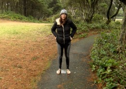 Alisha stands out in the open, in the middle of a public park, with her jeans soaked with pee.