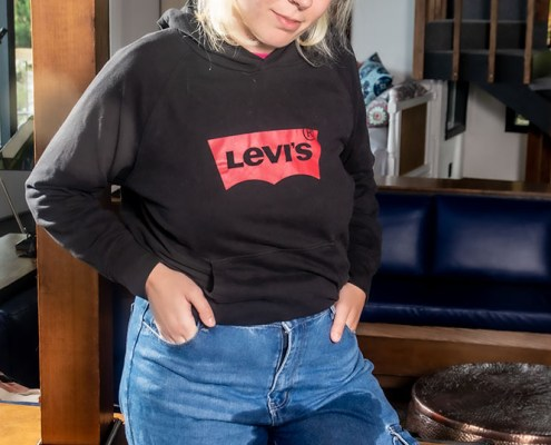 Olivia gives the camera a naughty glance as she shows off her peed in pants.