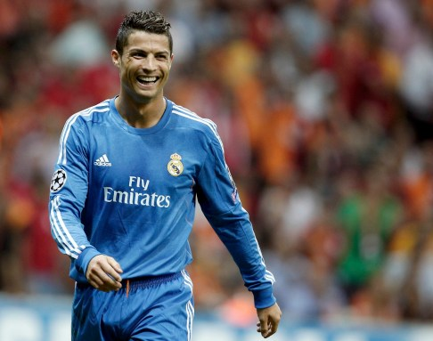 Real Madrid's Ronaldo smiles after scoring a goal against Galatasaray during their Champions League soccer match in Istanbul