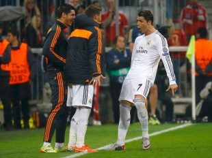 Real Madrid's Cristiano Ronaldo celebrates his second goal against Bayern Munich in front of teammates during their Champions League semi-final second leg soccer match in Munich