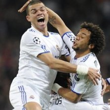 Marcelo (top R) celebrates with team-mates Pepe (top L) and Sergio Ramos_300