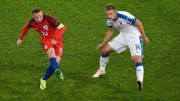 England's forward Wayne Rooney (L) vies wih Slovakia's defender Milan Skriniar during the Euro 2016 group B football match between Slovakia and England at the Geoffroy-Guichard stadium in Saint-Etienne on June 20, 2016. / AFP / JEAN-PHILIPPE KSIAZEK (Photo credit should read JEAN-PHILIPPE KSIAZEK/AFP/Getty Images)