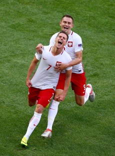 NICE, FRANCE - JUNE 12: Arkadiusz Milik (L) of Poland celebrates scoring his team's first goal with his team mate Artur Jedrzejczyk (R) during the UEFA EURO 2016 Group C match between Poland and Northern Ireland at Allianz Riviera Stadium on June 12, 2016 in Nice, France. (Photo by Alex Livesey/Getty Images)