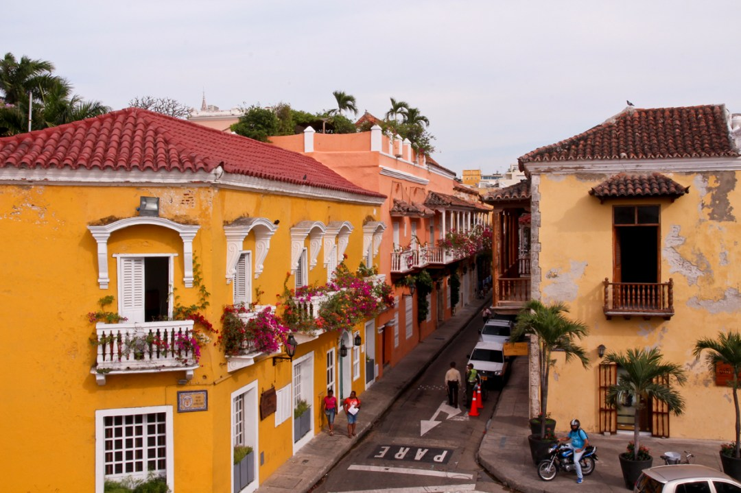 Colorful building with pink flowers in planters, Cartagena Colombia