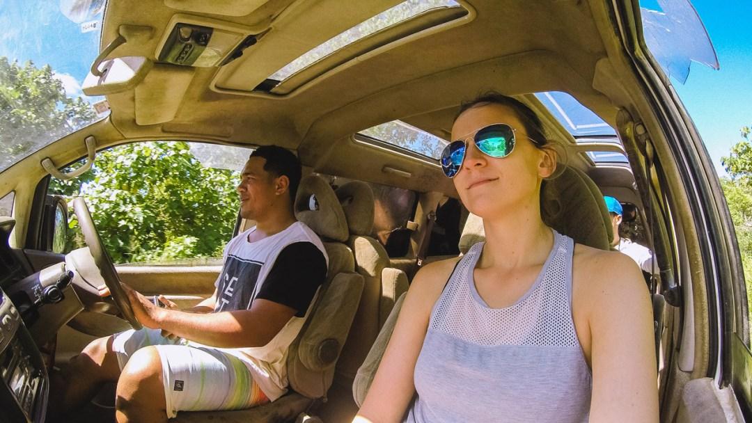 Sitting in passenger seat of minivan in 'Eua