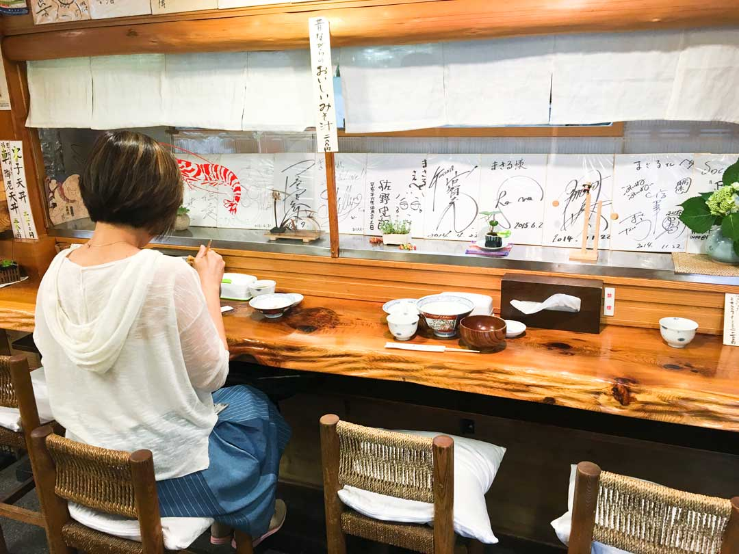Woman eating Tendon at Masura in Asakusa Tokoyo