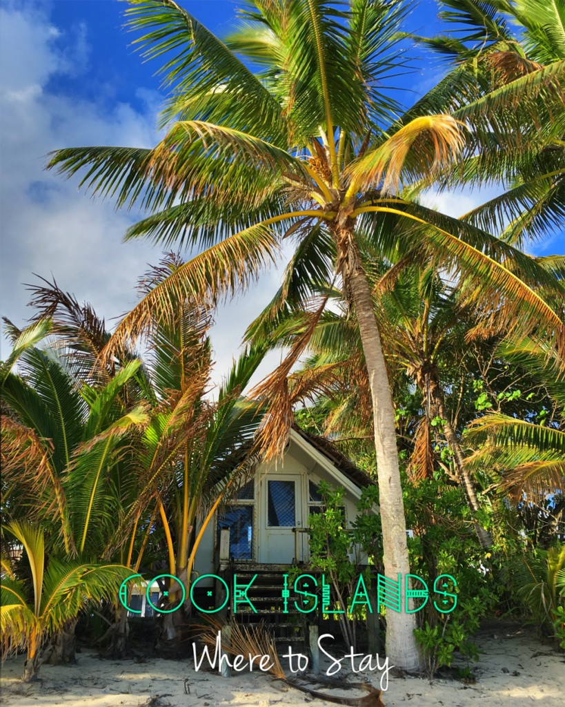 "Beach hut with large palm tree in front. Image text says"" Cook Islands: Where to Stay"""